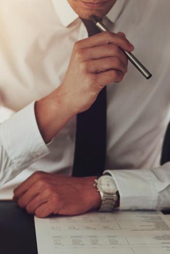 A man holding a pen